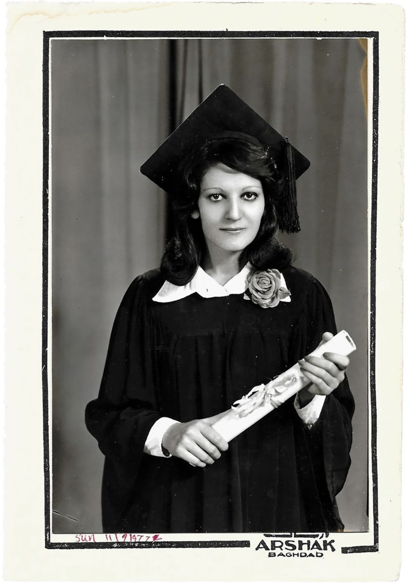 Archival graduation photo of a young woman