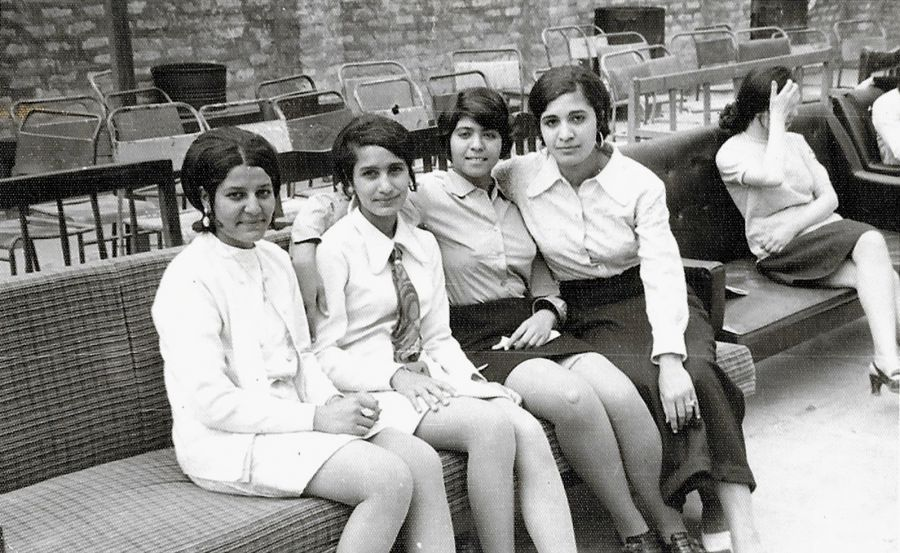Archival photo of a group of four young people posed for the camera