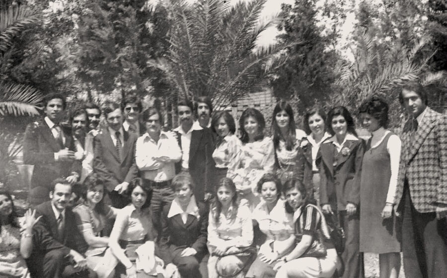 Archival photo of a group of young people posed for the camera