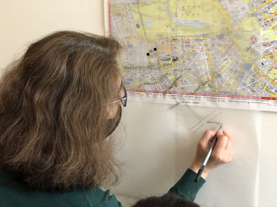 Woman draws an overlay over a map